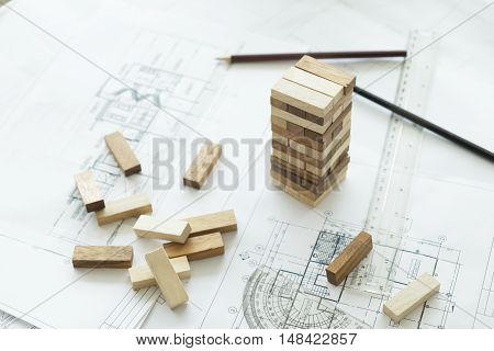 Planning risk and strategy of project management in business businessman and engineer gambling placing wooden block on a tower.Business and construction concept.