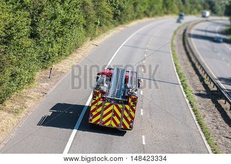 Fire engine with a ladder on the motorway