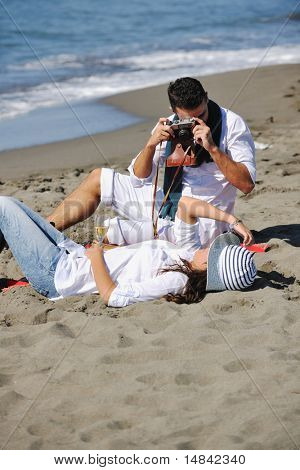 happy young couple relaxing in nature white making photos and taking images and posing for camera