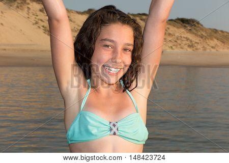 Girl In A Bikini Relaxes In The Sea Under The Sun