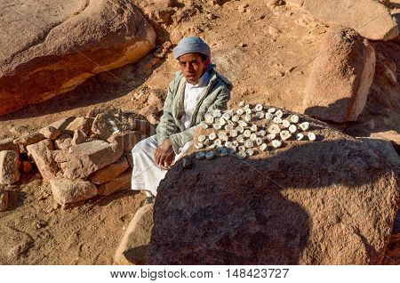 Sinai Egypt - November 25 2010: Bedouin guy near the Mount Sinai who sells local stones as souvenirs to hiking pilgrims and other tourists at November 25 2010
