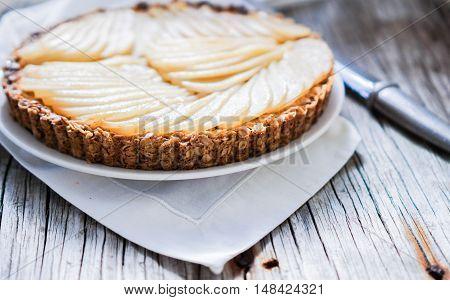 Healthy Pear Tart/ Vegan Dessert on Wood Background, Selective Focus, close up.