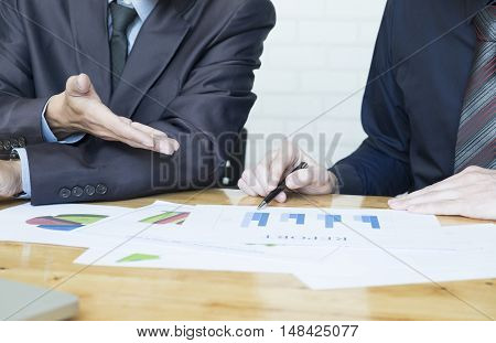 Business Team Discussing Their Ideas In Office.