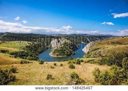 Meanders at rocky river Uvac gorge on sunny day, southwest Serbia.