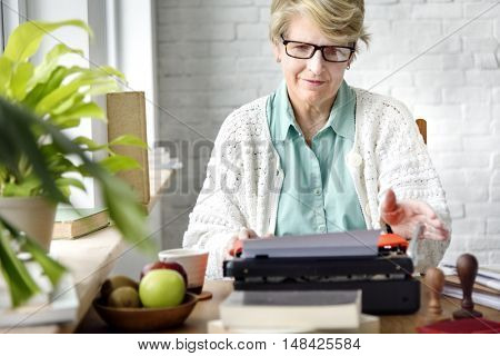 Senior Adult Using Typerwriter Typing Concept