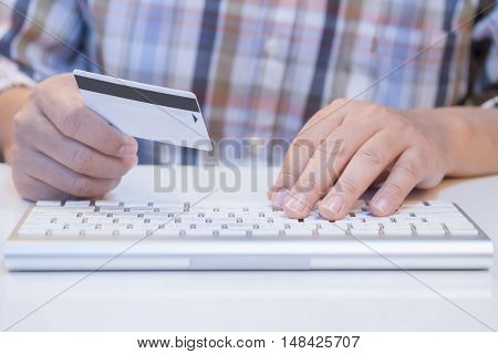 Man Online Shopping And Pay By Credit Card.