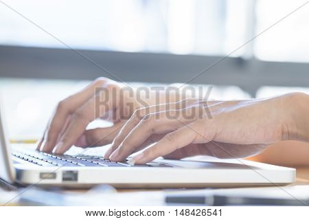 Asian Woman Using Laptop To Online Shopping.(selective Focus)