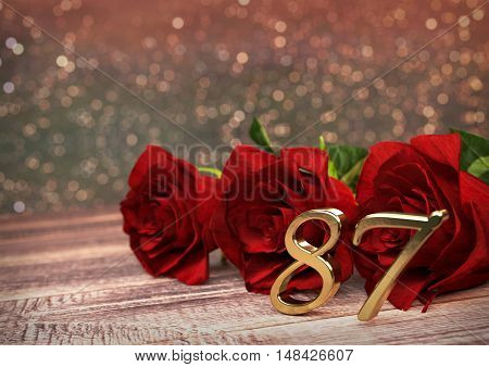 birthday concept with red roses on wooden desk. 3D render - eighty-seventh birthday. 87th