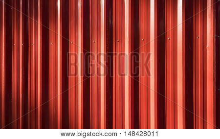Background and copyspace of red corrugated iron fence.
