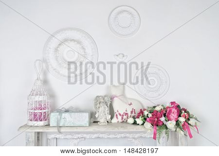 white wall with shelf with different objects of the interior