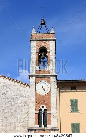 Belfry of Saint Francis church in San Quirico d'Orcia. Tuscany Italy