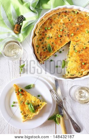 Green peas and lards quiche with white wine, top view