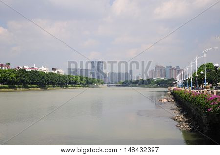 The Zhujiang River surrounded by the city of Guangzhou China on a sunny day.