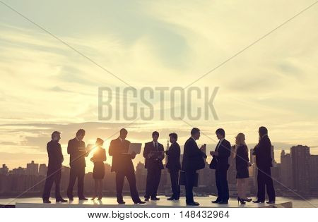 Business People Back lit Busy Cityscape Concept