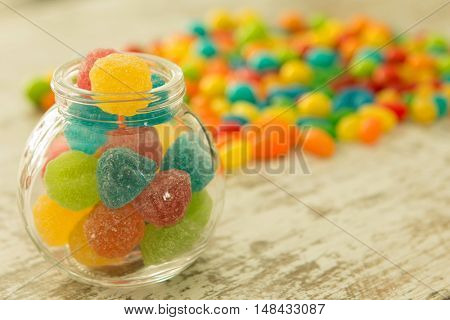Glass bowl full of colorful jelly beans. Focus in the foreground