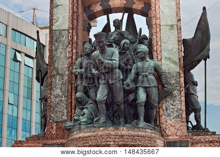 TURKEY, ISTANBUL - NOVEMBER 07, 2013: Elements of the famous Republic Monument on Taksim square. In center statue of Kemal Ataturk. Created by Italian sculptor Pietro Canonicain in 1928.