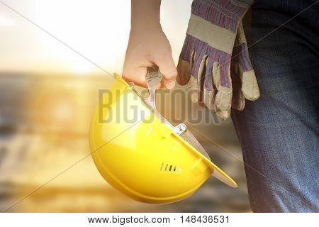 Worker in a construction site.  Sunlight background