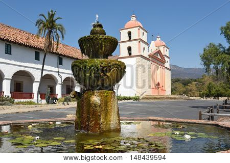 SANTA BARBARA, CALIFORNIA - SEPTEMBER 21, 2016: Fountain at the Santa Barbara Mission. Founded in 1786, the present day church was destroyed by an earthquake in 1925 and later restored.