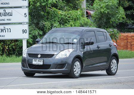 CHIANGMAI THAILAND -AUGUST 18 2016: Private Eco car Suzuki Swift. On road no.1001 8 km from Chiangmai city.