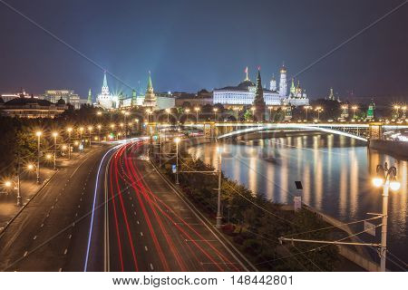 Night Moscow, view of the Kremlin and the bridge across the river, long exposure