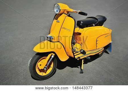 Genova, Liguria, Italy - September 18, 2016: Oktoberfest in Victory Square in Genoa, the first edition of motorsport meeting HBier rally dedicated to Vespas, Lambrettas and Fiat 500. Lambretta SX 150 Yellow