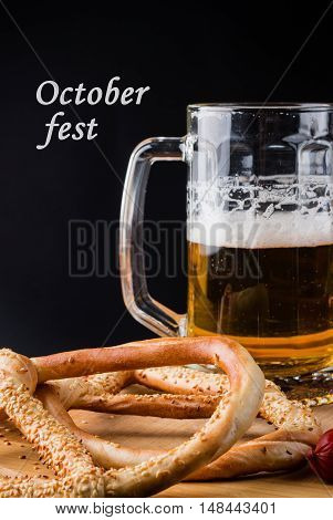 Glass Of Beer, Pretzel On Wooden Board With Text Octoberfest