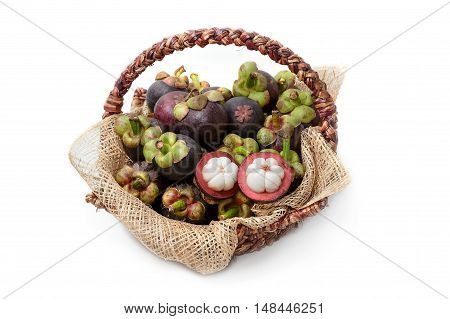 ripe mangosteen fruits in basket isolated on white background.