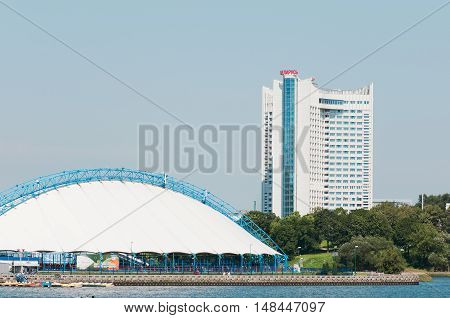 Minsk city, Belarus - August 6, 2016: View of the city of Minsk from the embankment of the river Svisloch, hotel.