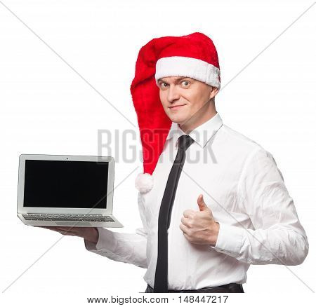 Men In White Shirt Black Tie And Red Santa Claus Heat Smiling And Showing Laptop In One Hand And Thu