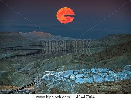 Rise of super-moon in Ein Avdat national Israeli park located in desert of the Negev