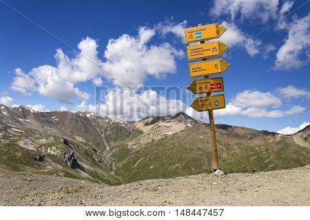 Footpath And Mountain Bike Direction Sign In Italian Alps Livigno