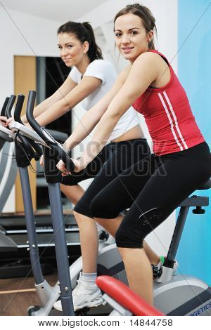 young woman exercise fitness and workout while run on track in sport club