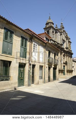 Street with traditional houses and the Bartholomew Church in the city of Pontevedra Galicia Spain.