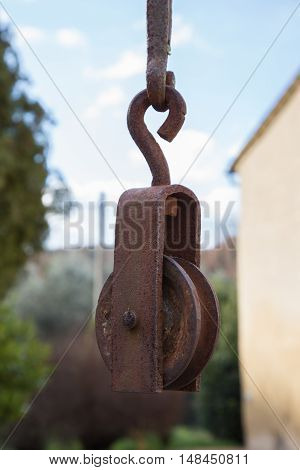 Old iron pulley attached to a well for water