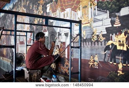 THAILAND - JANUARY 28: Craftsman work to restore the ancient painted fresco at Wat Phra Kaew Temple on January 28, 2011 in Bangkok, Thailand.