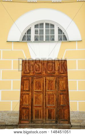 Sturdy wooden gates close the entrance to the building.