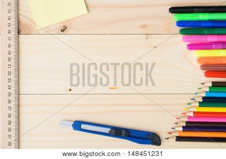 School and office supplies frame, on wooden background, back to school