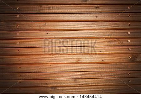 Retro wooden background. Old wooden wall. Lacquered wooden slats.