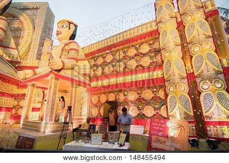 KOLKATA INDIA - OCTOBER 21 2015 : Beautiful exterior of decorated Durga Puja pandal at Kolkata West Bengal India. Durga Puja is biggest religious festival of Hinduism.