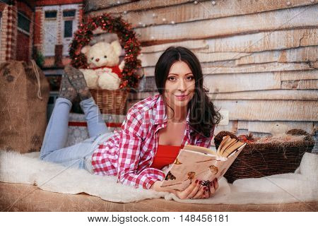 girl reading a book. The concept of the New Year and Merry Christmas.