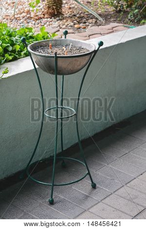 The Cigarette Ashtray stand in smoking area.