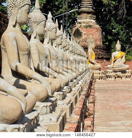 Line of buddha statue in WAT YAI CHAI MONGKOL, Popular tourist destination of Ayutthaya ,Thailand.