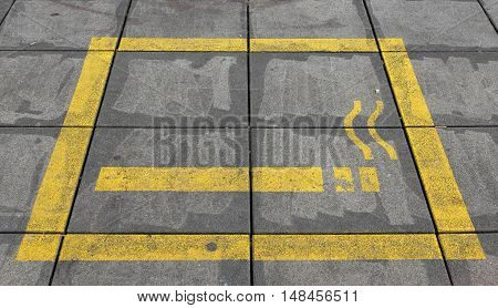 marked on the sidewalk area for smokers
