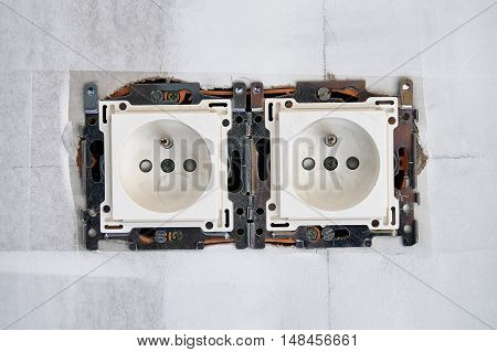 Electrical Outlet In Front Of White Wall