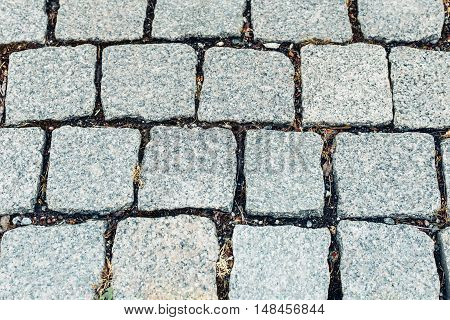 Dark grey stone pavement of the old pavers