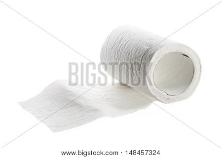 toilet paper roll half rolled out isolated on a white background selected focus