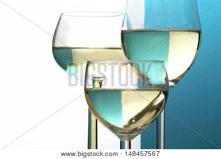 abstract wine glasses background half blue half white copy space selected focus