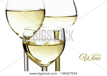 three glasses with white wine closeup isolated against a white background sample text