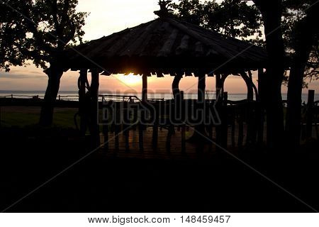 Silhouette of a arbor in the background of the setting sun the river Volga