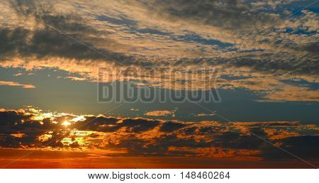 Fiery orange sunset sky background. Beautiful sky in evening time.